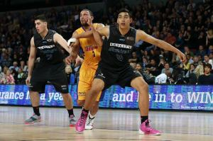 Tai Wynyard and Jordan Ngatai of the Breakers in action. 2014/15 ANBL, SkyCity Breakers vs Adelaide 36ers, Vector Arena, Auckland, New Zealand. Friday 17 October 2014. Photo: Anthony Au-Yeung / photosport.co.nz